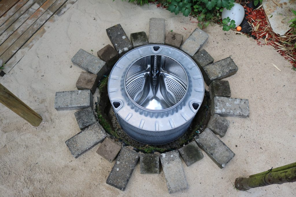 DIY-Feuerstelle-aus-Waschmaschinentrommel-bauen-4
